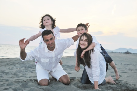 happy young family have fun and live healthy lifestyle on beach Stock Photo - 9715303