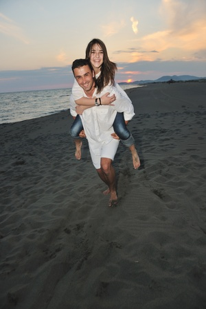 happy young couple have fun and romantic moments on beach at summer season and representing happynes and travel concept Stock Photo - 9720820
