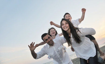happy young family have fun and live healthy lifestyle on beach Stock Photo - 9721798