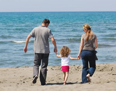 happy young family have fun and live healthy lifestyle on beach Stock Photo - 9724252