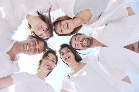 Group of happy young people in circle at beach have fun Stock Photo - 9723953