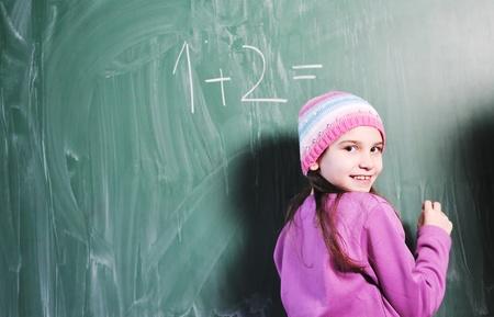 happy young school girl portrait on math class photo