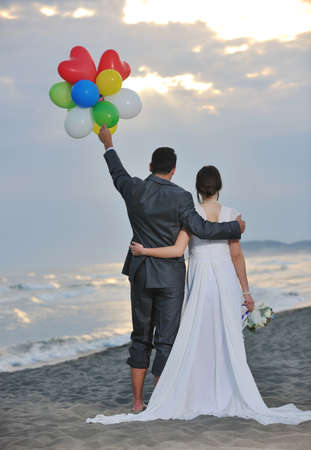 happy just married young couple celebrating and have fun at beautiful beach sunset Stock Photo - 9724711