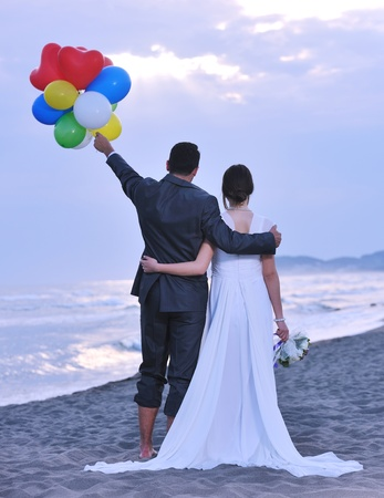 happy just married young couple celebrating and have fun at beautiful beach sunset Stock Photo - 9724548