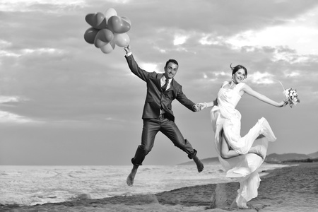 happy just married young couple celebrating and have fun at beautiful beach sunset Stock Photo - 9770562