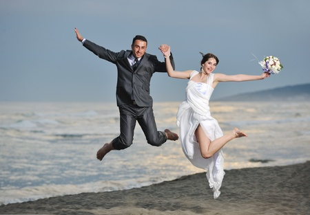 happy just married young couple celebrating and have fun at beautiful beach sunset Stock Photo - 9770581
