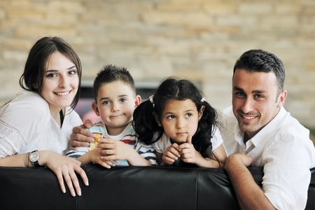 young family: happy young family relax and have fun at modern home indooor