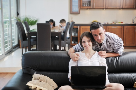 happy young family have fun and working on laptop at modern  home livingroom indoor Stock Photo - 9727728