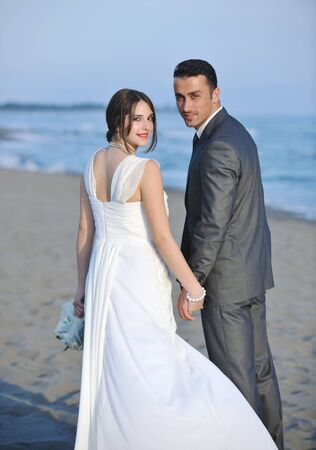 happy just married young couple celebrating and have fun at beautiful beach sunset Stock Photo - 9878204