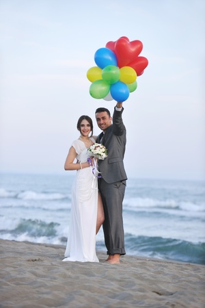 happy just married young couple celebrating and have fun at beautiful beach sunset Stock Photo - 9726213