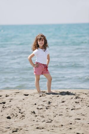 little female  child portrait on beautiful  beach photo