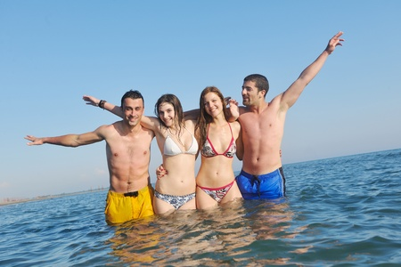 happy young people group have fun  run and jump  on beach beautiful sand  beach Stock Photo - 9900154