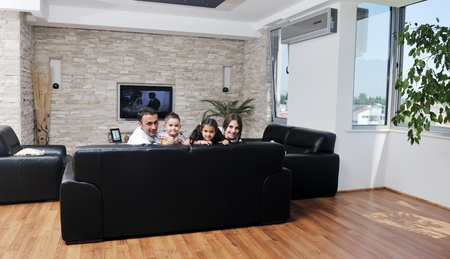 living together: happy young family relax and have fun at modern home indooor