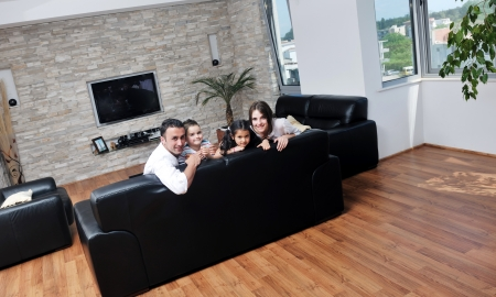 family in living room: happy young family relax and have fun at modern home indooor