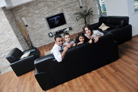 happy young family relax and have fun at modern home indooor photo