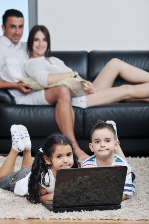 happy young family have fun and working on laptop at modern  home livingroom indoor Stock Photo - 9901616
