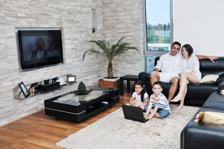 livingrooms: happy young family have fun and working on laptop at modern  home livingroom indoor