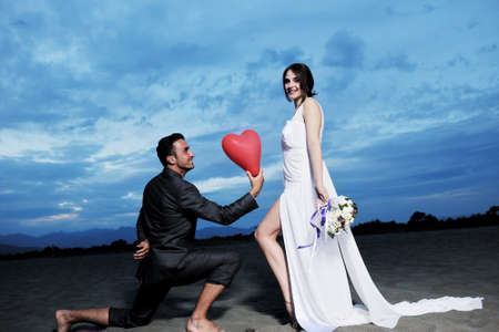 happy just married young couple celebrating and have fun at beautiful beach sunset Stock Photo - 9901185