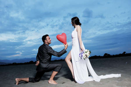 happy just married young couple celebrating and have fun at beautiful beach sunset Stock Photo - 9901174