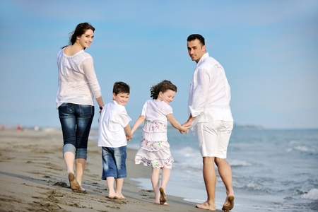 live happy: happy young family have fun and live healthy lifestyle on beach