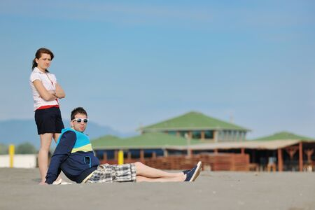 happy young couple have fun and romantic moments on beach at summer season and representing happynes and travel concept photo