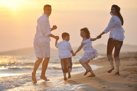 happy young family have fun and live healthy lifestyle on beach Stock Photo - 9936441