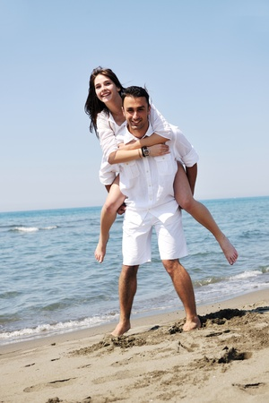 happy young couple have fun and romantic moments on beach at summer season and representing happynes and travel concept Stock Photo - 9936444