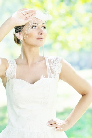 beautiful bride woman people in fashion wedding dress posing\ outdoor in bright park