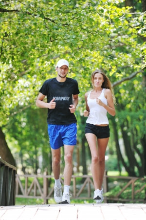 jogging in park: happy young younpe jogging and runing outdoor in nature at sunny day Stock Photo