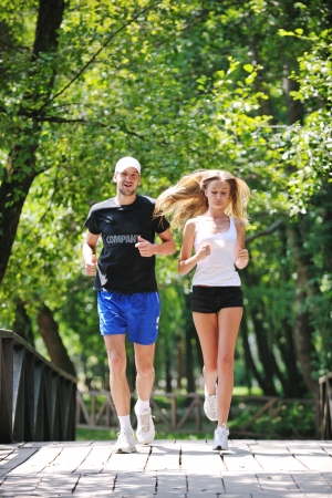 happy young younpe jogging and runing outdoor in nature at sunny day photo