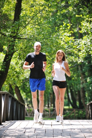 spring training: happy young younpe jogging and runing outdoor in nature at sunny day Stock Photo