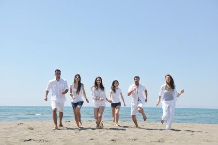 happy people group have fun  run and jump  on beach beautiful sand  beach Stock Photo - 10018966