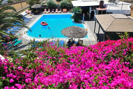 aegean sea: romantic balcony with flowers and swimming  pool view