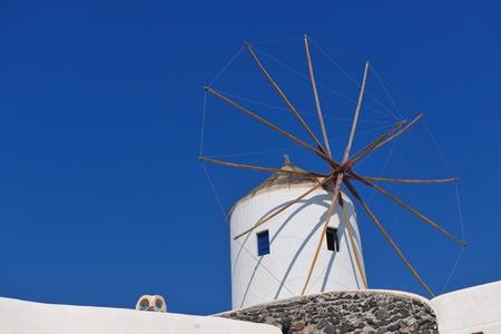 summer vacation on beautiful vulcanic island santorini at greece photo