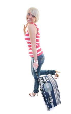 woman tourist packing travel bag isolated on white backgound in studio Stock Photo - 10244644