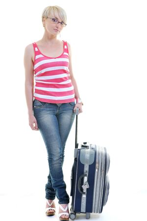 woman tourist packing travel bag isolated on white backgound in studio Stock Photo - 10244668