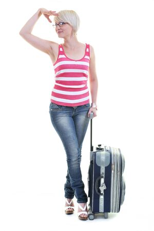 woman tourist packing travel bag isolated on white backgound in studio Stock Photo - 10244667