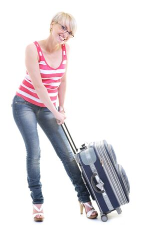 woman tourist packing travel bag isolated on white backgound in studio Stock Photo - 10244675