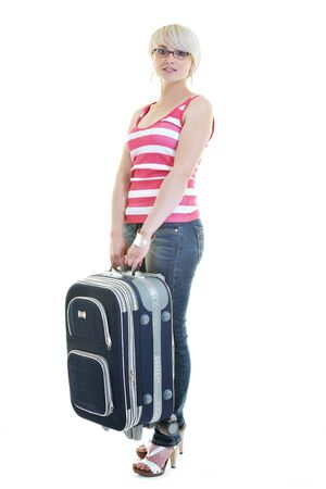 woman tourist packing travel bag isolated on white backgound in studio Stock Photo - 10244666