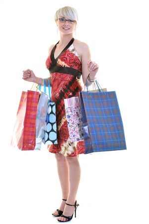 women shopping concept with young lady and colored bags  isolated over white background in studio Stock Photo - 10244765