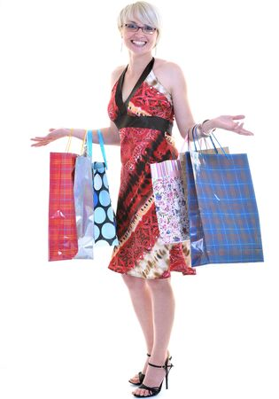 women shopping concept with young lady and colored bags  isolated over white background in studio Stock Photo - 10244767