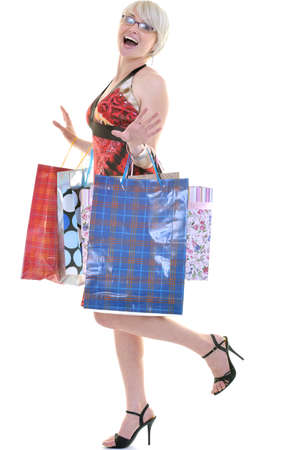 women shopping concept with young lady and colored bags  isolated over white background in studio Stock Photo - 10244750