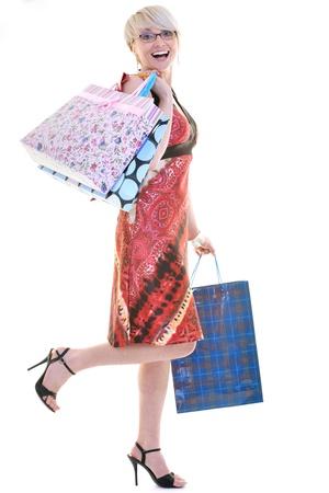 concepto de compras con la jovencita y colores bolsas aisladas sobre fondo blanco en el estudio de la mujer