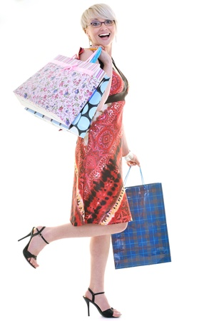 women shopping concept with young lady and colored bags  isolated over white background in studio Stock Photo