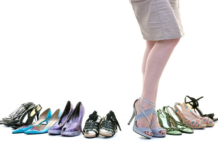 shoe collection: woman buy shoes concept of choice and shopping, isolated on white background in studio