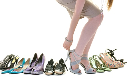 shoes fashion: woman buy shoes concept of choice and shopping, isolated on white background in studio
