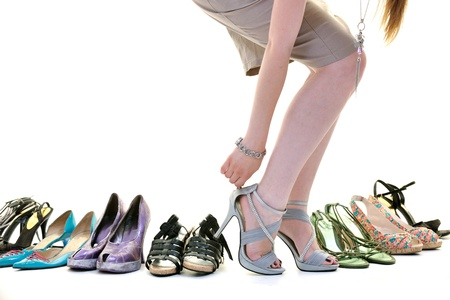 legs heels: woman buy shoes concept of choice and shopping, isolated on white background in studio