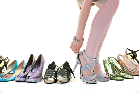 woman buy shoes concept of choice and shopping, isolated on white background in studio Stock Photo - 10191723