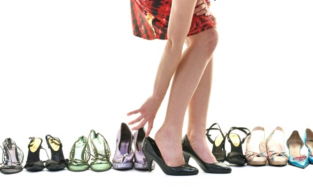 heels shoes: woman buy shoes concept of choice and shopping, isolated on white background in studio