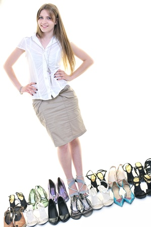 woman buy shoes concept of choice and shopping, isolated on white background in studio Stock Photo - 10244830